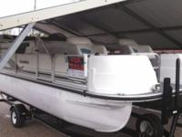 2000 Landau DX 18 Pontoon boat with the matching Landau