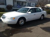 Options:  2000 Lincoln Continental Base 4Dr