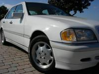 Options Included: CD Changer, Leather Seats, Cassette,