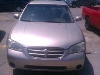 Up for sale is a beige 2000 Nissan Maxima GXE with