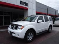 Silver Nissan Pathfinder SE, runs great. This is a
