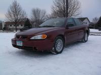 Our 2000 Pontiac Grand Am SE1 sedan is the perfect