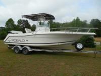 You are looking at a super clean, low hour 2000 Robalo