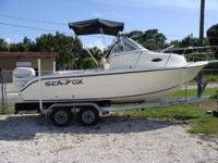 Walkaround Cuddy, 200 HP Evinrude , Magic tilt Trailer,
