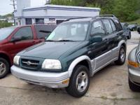 Options Included: 2000 Suzuki Grand Vitara with 98k!