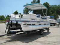 This lovely pontoon has a Mercury force 40 engine, a