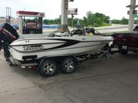 Here is a nice Triton 189 bass boat/double console