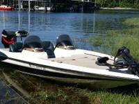 2000 Triton 20' bass boat with 200 Mercury, 74 lb foot