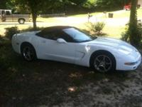 2000 white convertible corvette with black interior.