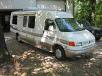 You are looking at a 2000 Winnebago EuroVan Rialta in