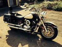 The bike has a clock, a temperature gauge, windshield,