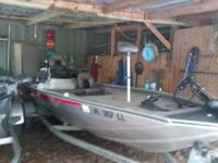 This is a 2000 Bass Tracker watercraft. alumium,185