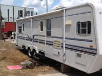 "2000 SunnyBrook 30' 10"" travel trailer with a 21'"