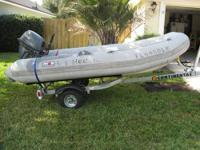 This is a 2001 Avon 12' Inflatable with fiberglass