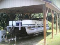 2001 Lowel 20 foot pontoon boat with 90 hp Johnson