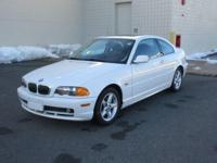 You are looking at an immaculate White, 2001 BMW 325Ci.