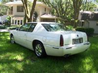 PREOWNED 2001 CADDY EL DORADO ESC COUPE. PEARL IVORY
