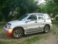 super nice 2001 chevy tracker 2x4 wd, power windows,