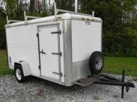 2001 6'X12' ENCLOSED TRAILER W/ LADDER RACK. Interior