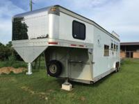 This is a 2001 EBY Legacy series three horse slant load