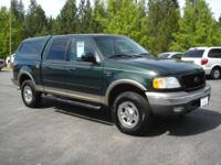 This Ford F150 is a SuperCrew Lariat Short Bed 4x4 with