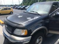 2001 Black F-150 Ford Lariat Hot Options include,