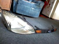 2001 Ford Focus SE right headlamp assembly, some tabs