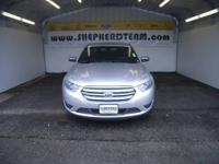 It is a silver Ford Taurus. Some hail damage. It has