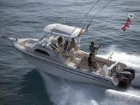 At the stern the transom door gives access to the swim