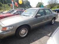 2001 Grand Marquis LS Color is silver Grey cloth
