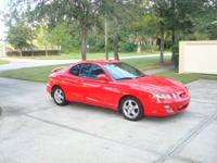 This is a two door automatic 2001 Hyundai Tiburon with