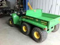 For sale is a 2001 John Deere Gator 6x4, lift bed, 694