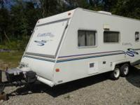 This camper is a 2001 Keystone Camplite Ultra - White.