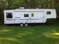 2001 Keystone Montana M-3255RL 5th Wheel. Length 33FT-