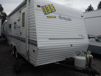 This Keystone Springdale 5th wheel features an outdoor