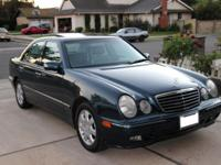 Offering 2001 Mercedes E-320. Color dark blue-green