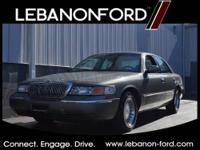 Feast your eyes on this sage 2001 Mercury Grand Marquis