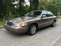 2001 Mercury Grand Marquis, 87,154 miles. Cost: