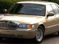 This Green 2001 Mercury Grand Marquis GS might be just