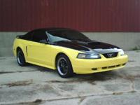 Available is a 2001 Ford Mustang GT with the costs