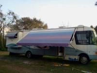 2001 National Dolphin Triton Class A Length 33ft Sleeps