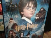 This is a framed 27 X 41 original Harry Potter movie