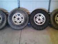 set of four rims off a 2001 ford ranger 4x4. Tires are