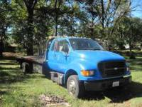 2001 Ford F650 DRW Rollback Wrecker. Owner retired from