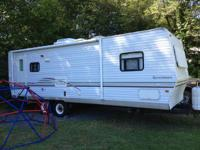 26 Foot travel trailer with one 12 foot slide. Rear
