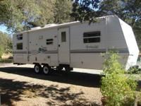 31 foot 2001 Springdale by Keystone travel trailer.