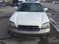 2001 Subaru Outback with 200k miles. Runs and drives