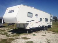 This 33' 5th wheel Toy Hauler offers a 18' garage floor