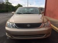 2001 Gold Toyota Avalon with leather interior. It has a