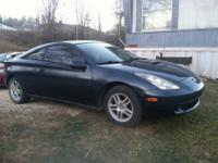 I have a dark metallic green 2001 Toyota celica for